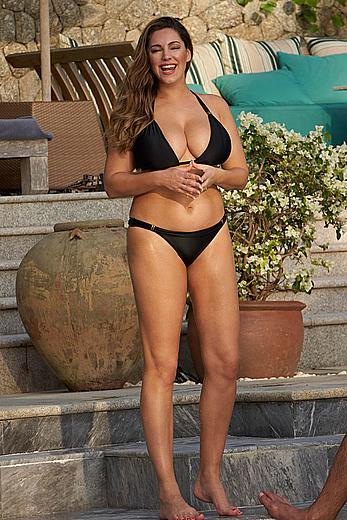 Busty Kelly Brook deep cleavage in black bikini in South East Asia