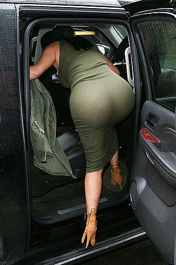 Kim Kardashian ass crack under tight see through dress