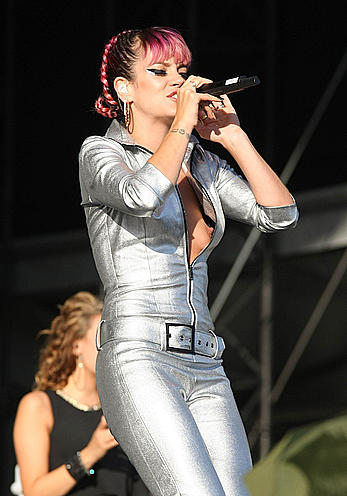 Lily Allen shows titslip on a stage