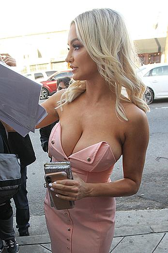 Lindsey Pelas deep sexy cleavage in tight pink dress