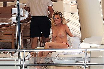 Melanie Griffith topless goes for a massage aboard a Yatch in Ibiza