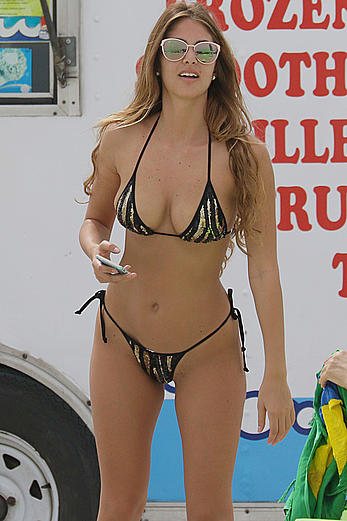 Melissa Castagnoli shows off curves in tiny black thong bikini