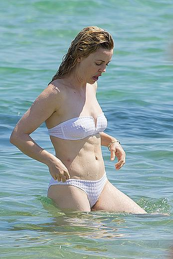 Melissa George pokies in white wet bikinii at a beach in St Tropez
