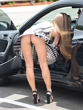 Melissa Lori upskirt shows her ass and panties
