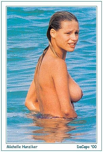 Michelle Hunziker sunbathing topless on a beach