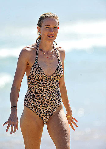 Naomi Watts wearing a swimsuit at a beach in Australia