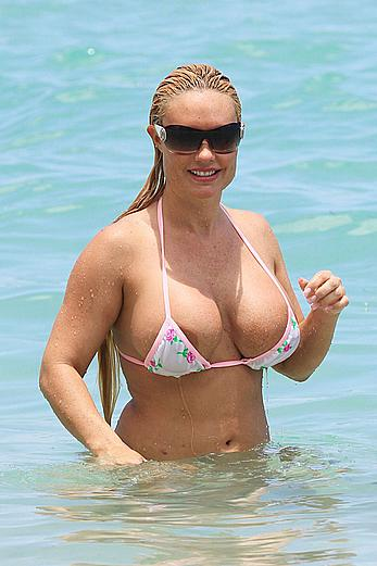 Nicole Coco Austin in a thong bikini shows areola slip in Miami Beach