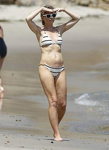 Rebecca Gayheart in a bikini on a beach in Malibu