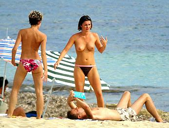 Sadie Frost topless on a beach