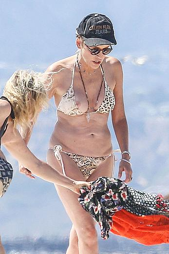 Sharon Stone tit slip in bikini in Venice