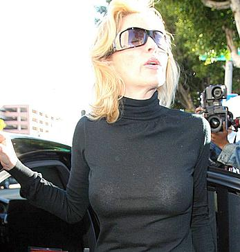 Sharon Stone without bra under see through top