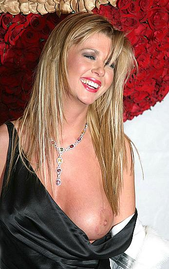 Tara Reid oops, boob out at P Diddy's Ball party