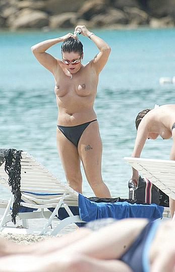 Jessie Wallace topless on a beach