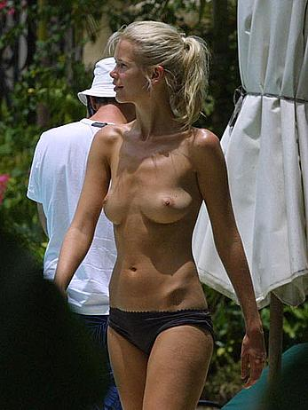 German supermodel Claudia Schiffer topless poolside paparazzi shots