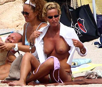 Federica Mancini sunbathing topless on a beach