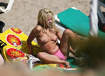 Peaches Geldof sunbathing topless on a beach paparazzi photos