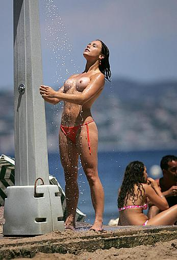 Sam Heuston topless under shower on a beach