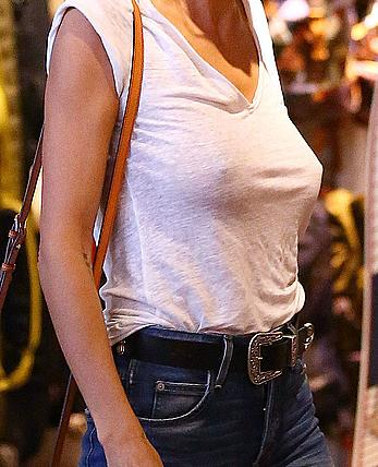 Heidi Klum braless shopping at Burton Flagship Store