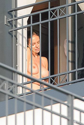Anna Wendzikowska flashes her boobs and bush on a balcony in her hotel in Warsaw