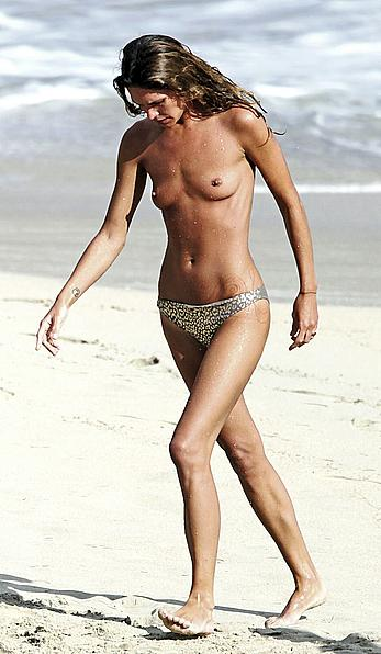 Erin Wasson topless on a beach