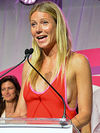 Gwyneth Paltrow sideboob as she attends the Hamptons Paddle & Party For Pink