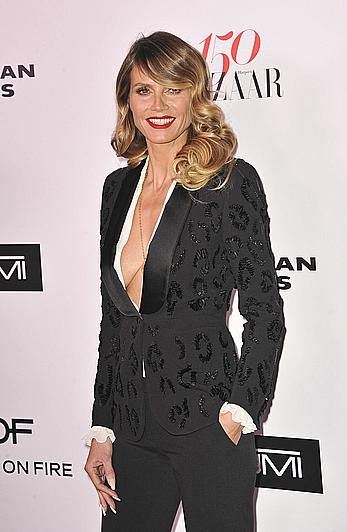 Heidi Klum sexy at Harpers Bazaar 150 Most Fashionable Women party