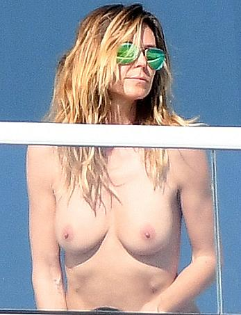 Heidi Klum topless on her hotel balcony in Miami