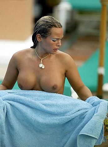 Holly McGuire topless poolside in Marbella