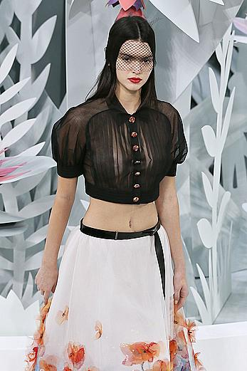 Kendall Jenner in see through blouse at fashion show in Paris