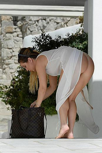 Lauryn Goodman upskirt shows her tight round ass in Mykonos