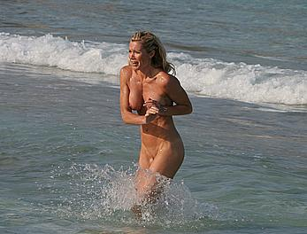 Nell McAndrew fully nude on a beach in Barbados