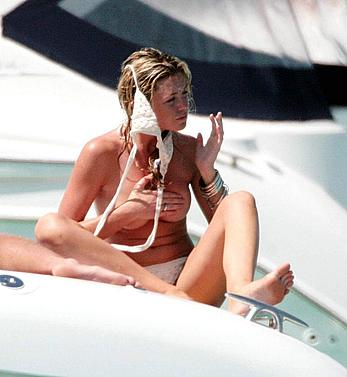 Abigail Clancy caught topless on a yacht