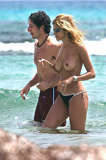 Adriana Volpe caught topless on a beach