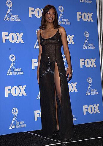 Aisha Tyler without bra under semi-transparent dress