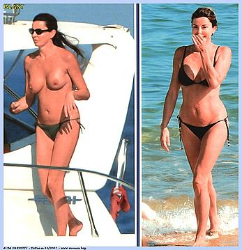 Alba Parietti topless on a beach and yacht