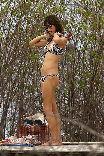 Supermodel Alessandra Ambrosio in bikini on a beach in Brazil