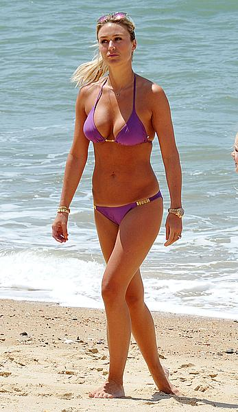Alex Gerrard shows sexy cleavage on the beach in Portugal