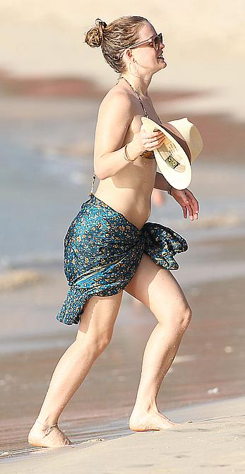Alice Eve wearing a bikini at a beach in Barbados