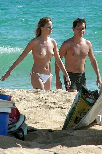 Alicia Bogo caught topless on a beach