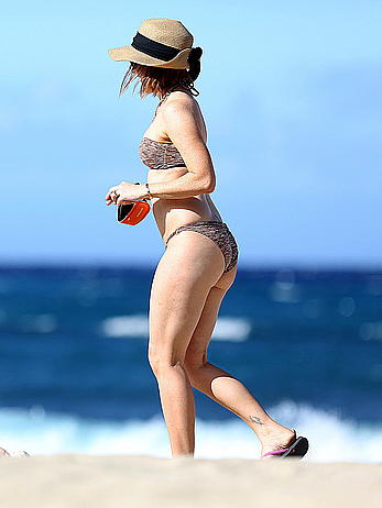 Alyson Hannigan in bikini on a beach in Hawaii