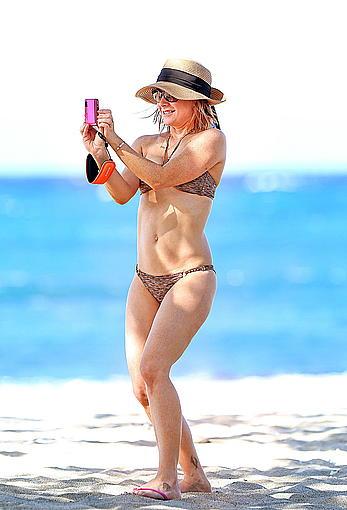 Alyson Hannigan in bikini on a beach in Hawaii