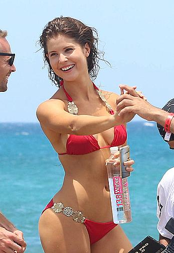 Amanda Cerny in red bikini shooting a music video in Aruba