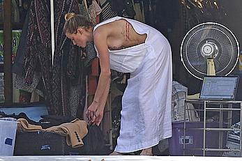 Amber Heard has tit slip while cleaning out her garage