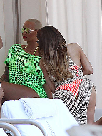 Busty Amber Rose in see through yellow bikini top by the pool in Miami