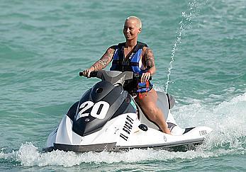 Busty Amber Rose wearing a bikini at a beach in Miami