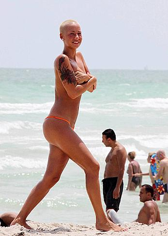 Amber Rose topless on a beach