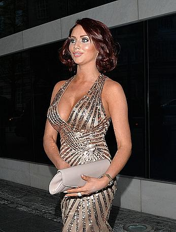 Busty Amy Childs attends the Soldiering on awards at the Park Plaza hotel in London