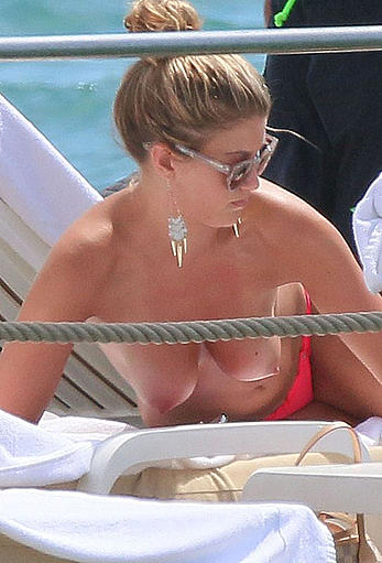 Amy Willerton sunbathing topless in Cannes