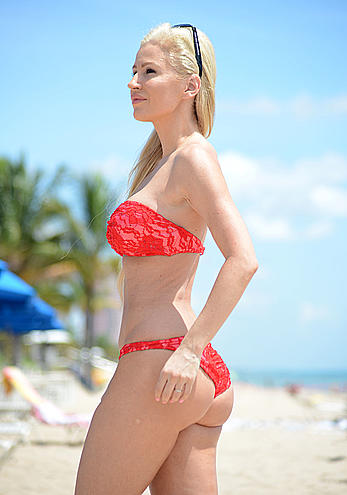 Ana Braga sexy in red bikini candids