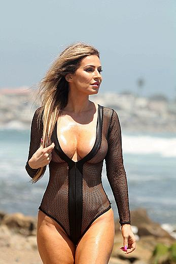 Ana Braga wearing a fishnet swimsuit on a beach in Malibu